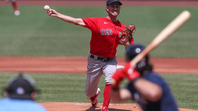 The Red Sox' Ryan Weber delivers a pitch during an intrasquad game at Fenway Park on Saturday. Weber, who's in line for one of the openings in the starting rotation, worked four innings.