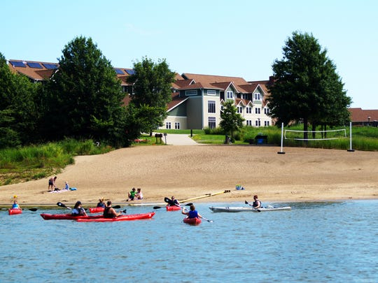 Kayakers hit the lake outside Honey Creek Resort in Moravia, Ia.