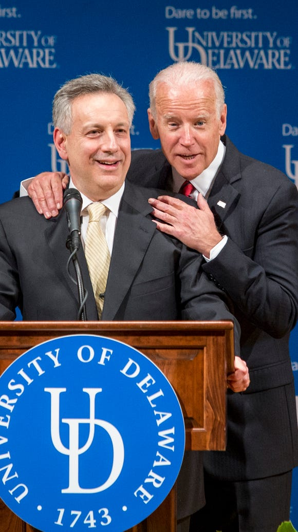 Former Vice President Joe Biden pats University of