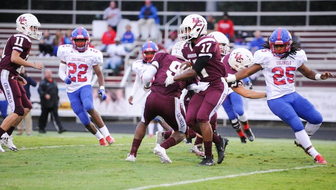 Henderson County's Isaiah Easley looks for an opening will running the ball down the field during Friday's game with Christian County at Colonel Stadium.