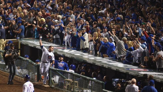 Miguel Montero of the Cubs celebrates after hitting a grand slam in the eighth inning against the Dodgers.