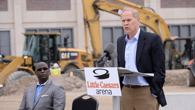 Michigan coach John Beilein gives his remarks during Tuesday's press conference while Detroit Mercy coach Bacari Alexander looks on.