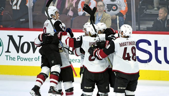 Oct 30, 2017: Arizona Coyotes celebrate game-winning goal during the overtime period against the Philadelphia Flyers at Wells Fargo Center.