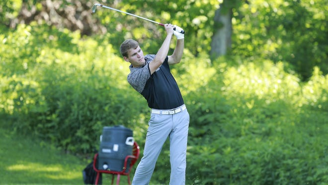 Mishicot's Austin Schnell tees off on the 14th hole at the WIAA Division 3 state boys golf tournament Tuesday at University Ridge Golf Course in Madison.