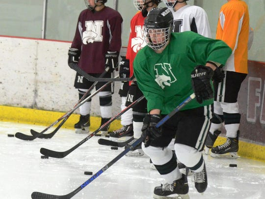 Novi varsity hockey players go through the paces in