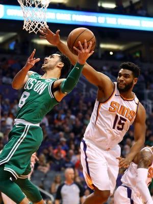 Mar 26, 2018: Boston Celtics guard Shane Larkin (8) has his shot blocked by Phoenix Suns forward Alan Williams (15) in the second quarter at Talking Stick Resort Arena.