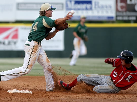 Lincoln's Blake Reese tries to turn as double play