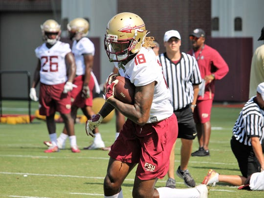 FSU WR Warren Thompson catches a pass during the third practice of fall camp