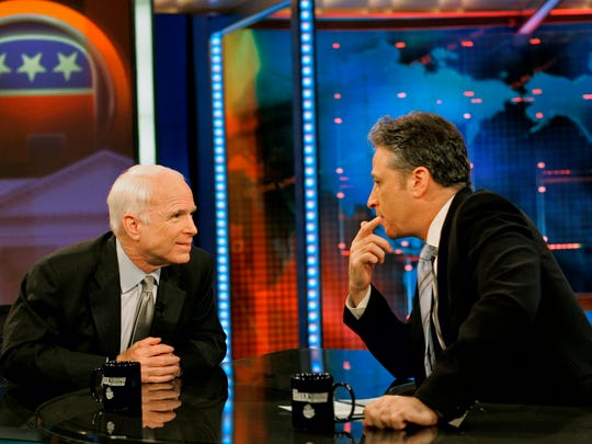 "Republican presidential candidate, Sen. John McCain, R-Ariz., left, speaks with host Jon Stewart during a break at a taping of ""The Daily Show"" on May 7, 2008 in New York City."