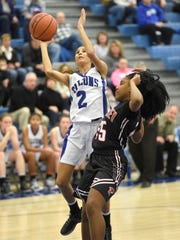 Falcon guard Ariel Jones drives past McCaskey's Brooklyn Smith-Jones to score two of her game-high 18 points.