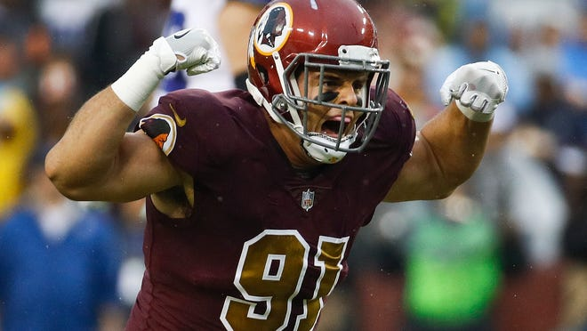 FILE - In this Oct. 29, 2017, file photo, Washington Redskins outside linebacker Ryan Kerrigan (91) celebrates his sack of Dallas Cowboys quarterback Dak Prescott during the first half of an NFL football game in Landover, Md. Washington comes off a comeback victory at Seattle made more impressive by the wave of injuries it has fought through. Its defense has looked formidable, led by LBs Zach Brown and Ryan Kerrigan. (AP Photo/Patrick Semansky, File) ORG XMIT: NYDD332