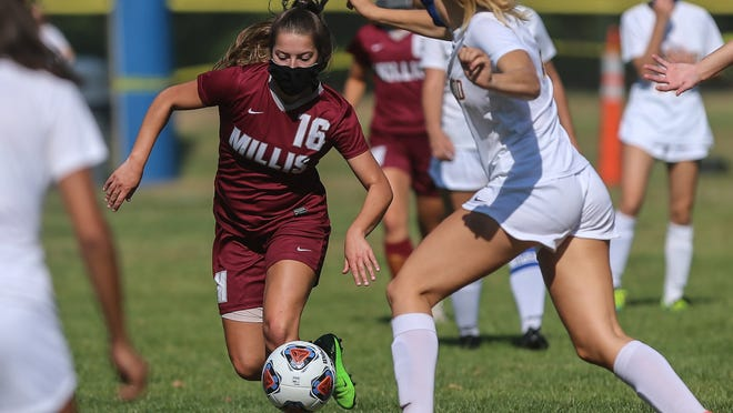 Millis senior Jordyn Ferrantino steals the ball during a girls soccer game against Norwood at Millis High School on Saturday.