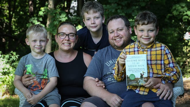 Author Aaron Gouveia, his wife M.J., and sons Tommy, 4, Sammy, 6, and Will, 12, pose for a photo at their home in Franklin.