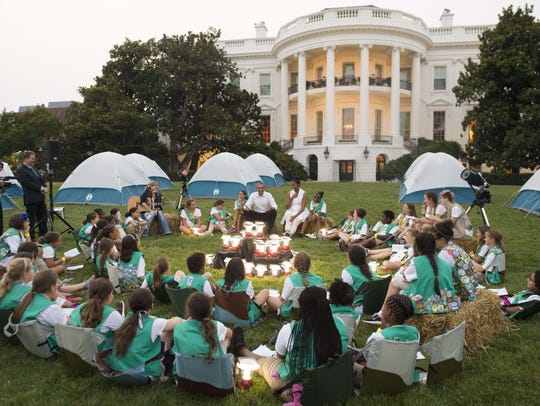Girl Scouts, some shown here in June meeting at the