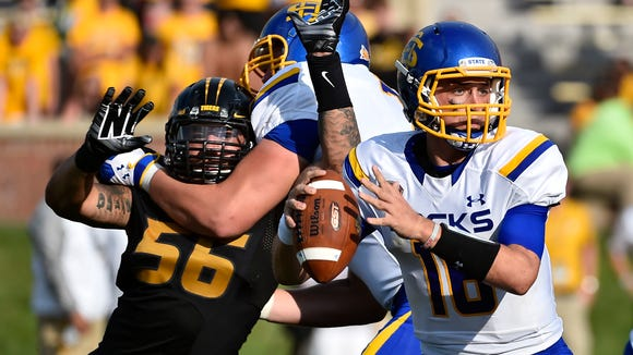 SDSU quarterback Zach Lujan attempts a pass under pressure from Missouri Tigers defensive lineman Shane Ray during the season opener on Aug. 30. On Saturday, the Jackrabbits host D-III Wisconsin-Oshkosh. It's the last game for the Jacks before conference play kicks off on Oct. 4 against Illinois State.
