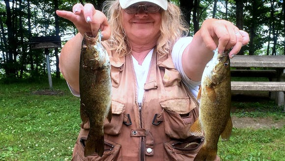 Carol caught several smallmouth bass during her first