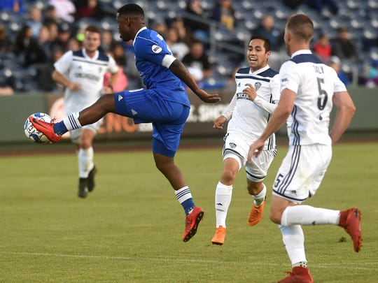 Reno 1868 FC's Lindo Mfeka (10) tries to control the ball while taking on Fresno FC at Greater Nevada Field in Reno on June 9, 2018.