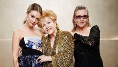 Billie Lourd, Carrie Fisher and Debbie Reynolds pose