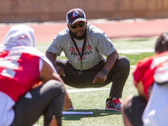 Southern Utah defensive coordinator Rod Chance stretches