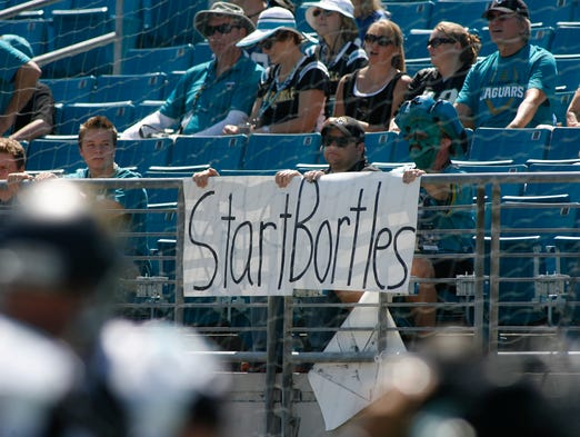 Jacksonville Jaguars fans watch above a sign suggesting they start quarterback Blake Bortles before the start of their game against the Indianapolis Colts at EverBank Field.