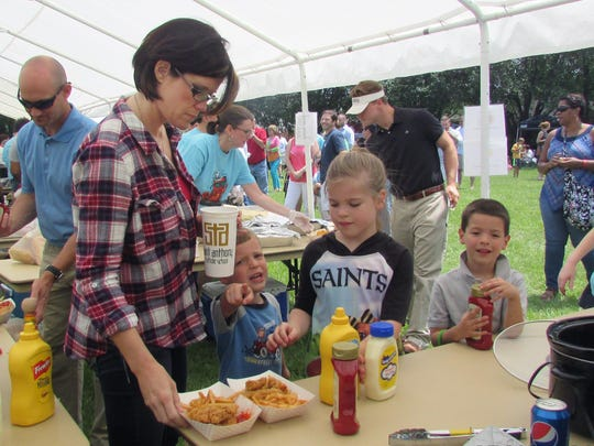Festival attendees enjoy a wide variety of food during the 2016 St. Francis Cajun Fest. This year's event includes every kind of Cajun food plus chicken strips, fries and hot dogs. There will also be live music, craft vendors, a general store, toy store, used bookstore and children's activities.