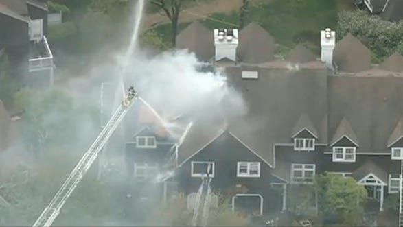 Firefighters battle a smoky fire at 25 Turnberry Drive in the St. Andrew's Golf Club condominiums in Greenburgh after a fire and explosion on May 14, 2014.