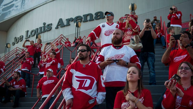 Detroit Red Wings fans watch as players arrive at Joe Louis Arena for the season opener against the Ottawa Senators on Oct. 17, 2016.