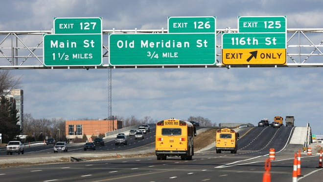 Vehicles drive north over US the 116th St. bridge on US 31, Friday, December 18, 2015.  106th and 116th Streets over US 31 are now open in Carmel.