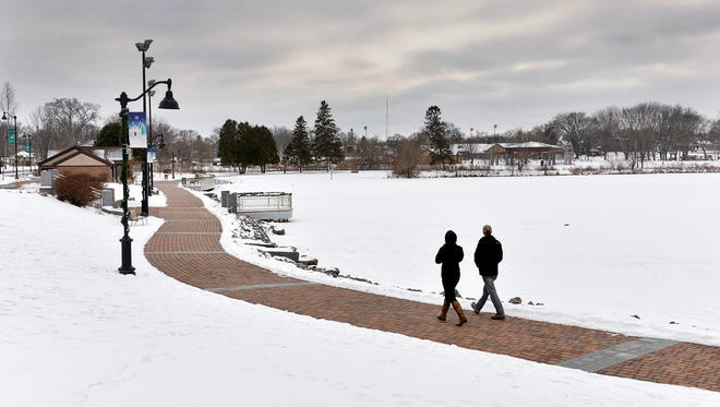 A snow-covered Lake George is conspicuously unusable for skating Friday, Jan. 8, as the warm winter so far has made the lake more of a walking destination.