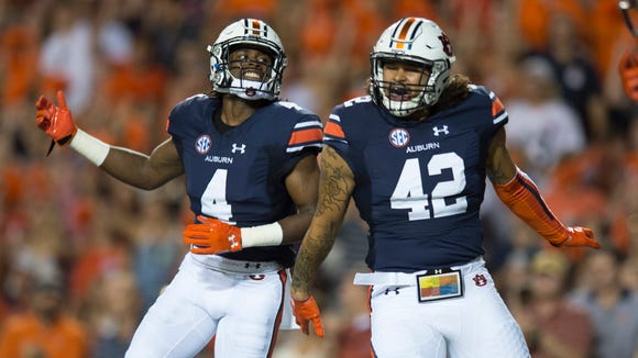 Auburn linebacker Jeff Holland (4) and Auburn linebacker Tre' Threat (42) celebrate after a kickoff during the Auburn vs. Clemson NCAA Football game at Jordan-Hare Stadium on Saturday, Sept. 3, 2016, in Auburn, Ala. 
