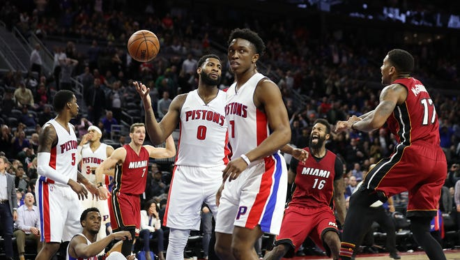Pistons center Andre Drummond (0) and forward Stanley Johnson react after the Pistons' 97-96 loss Tuesday at the Palace.