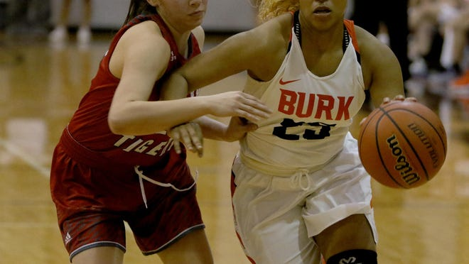 Burkburnett's Eternity Jackson drives to the basket next to Glen Rose's Hailey Ibarra in the Region I-4A Area playoff Thursday, Feb. 16, 2017, in Jacksboro. Glen Rose defeated Burkburnett 63-54.