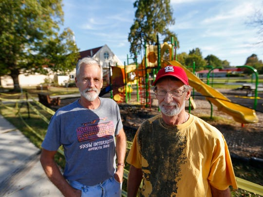 Brothers Tim, left, and Tom Penn pulled a woman from a burning SUV after it crashed into the playground at Messiah Lutheran Church last week.