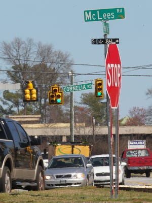 Cars drive at noon on Greenville Street on Wednesday, between McLees Road and Cornelia Road, in Anderson.
