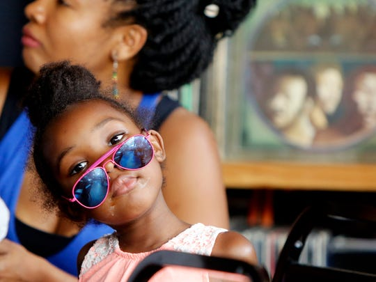 Araba Micah, 4, daughter of Naimah Bilal, attends the  Elementz Block Party in Over-the-Rhine on Friday. Talib Kweli performed for the urban arts center ahead of the Cincinnati Music Festival.