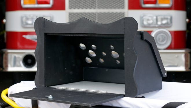 A prototype of a baby box, where parents could surrender their newborns anonymously, is shown Feb. 26, 2015, outside the fire station in Woodburn, Ind.