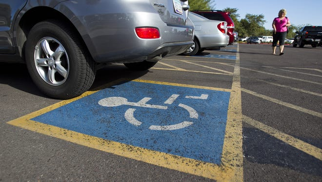 """House Bill 2408 would mandate that wider spaces be labeled """"wheelchair-only,"""" allowing only people with proof of a wheelchair-specific disability to park there."""