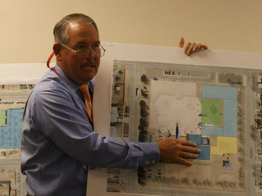 Construction Management Director Herb Borden presenting a conceptual plan for improvements at Chaparral Elementary School during Thursday's school board meeting.