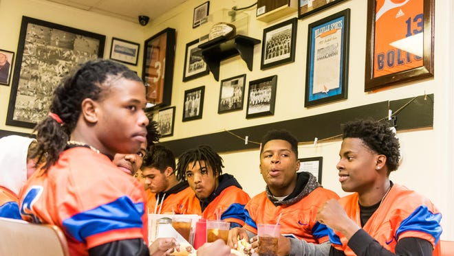 Millville football players enjoy a free meal at Jim's Lunch to celebrate their South Jersey Group V state championship victory on Tuesday, December 6.