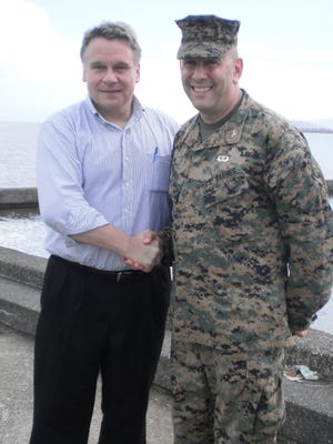 On a Congressional trip to review typhoon recovery efforts in the Philippines in 2013, Rep. Chris Smith meets Col. Eric Mellinger, whom Smith nominated to a military service academy shortly after he began his career in Congress in 1982.