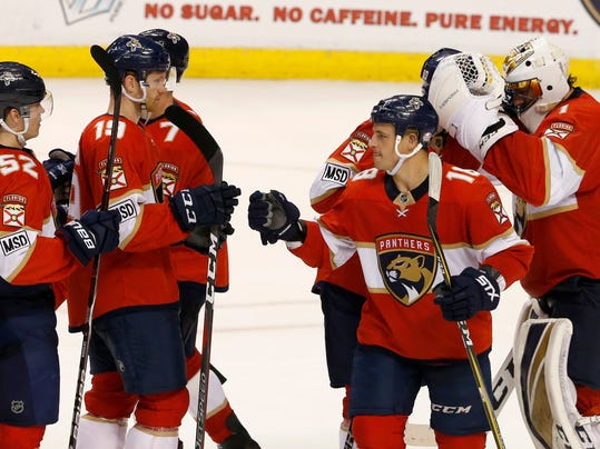 Florida Panthers players including goaltender Roberto Luongo, right, celebrate their 2-1 win over the Nashville Predators in an NHL hockey game, Tuesday, April 3, 2018, in Sunrise, Fla. (AP Photo/Joe Skipper)