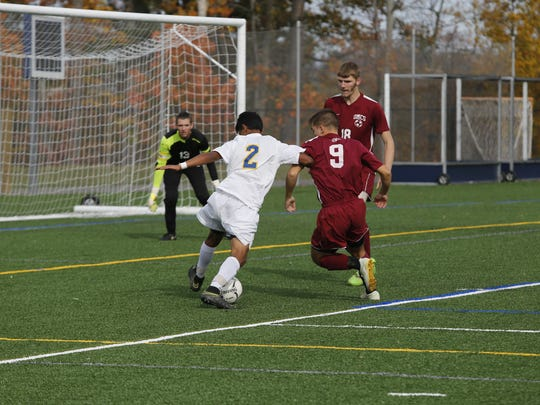 Lansing's  Langston Hopkins, left, attempts to hold off Odessa-Montour's Alec Betts on Saturday at Ithaca College.