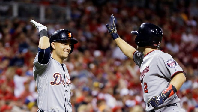 American League's Brian Dozier, of the Minnesota Twins, celebrates with American League's Jose Iglesias, of the Detroit Tigers, after hitting a home run during the eighth inning of the MLB All-Star baseball game, Tuesday, July 14, 2015, in Cincinnati.