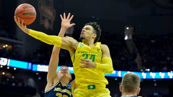 Mar 23, 2017; Kansas City, MO, USA; Oregon Ducks forward Dillon Brooks (24) goes up for a shot as Michigan Wolverines guard Duncan Robinson (22) defends during the first half in the semifinals of the midwest Regional of the 2017 NCAA Tournament at Sprint Center. Mandatory Credit: Denny Medley-USA TODAY Sports