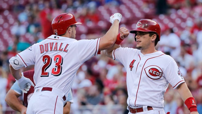 Cincinnati Reds left fielder Adam Duvall (23) is congratulated by Cincinnati Reds second baseman Scooter Gennett (4) after hitting a two-run home run in the first inning during the National League baseball game between the Milwaukee Brewers and the Cincinnati Reds on June 27, 2017 at Great American Ball Park.