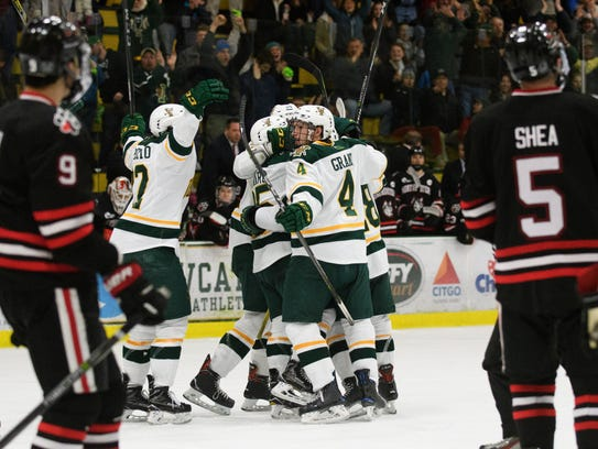 Vermont celebrates scoring a goal with just seconds