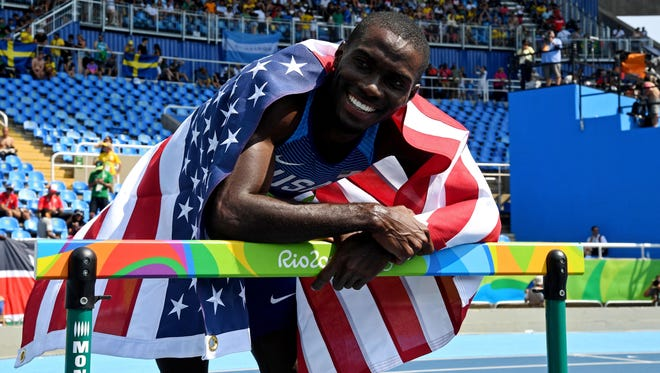 Kerron Clement celebrates his gold medal in the 400 hurdles.