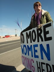 Kim Shipton, with the Coalition for Life of Las Cruces stands with a group of other pro life activists on Lohman Avenue, Celebrating the recent closure of the Whole Woman's Health Clinic, Friday January 27, 2017.