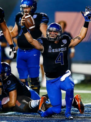 Memphis quarterback Riley Ferguson (right) celebrates a second-quarter touchdown against Bowling Green on Sept. 24, 2016, at Liberty Bowl Memorial Stadium. Ferguson finished the first half with 359 yards passing, completing 20 of 27 throws, and accounted for seven total touchdowns.