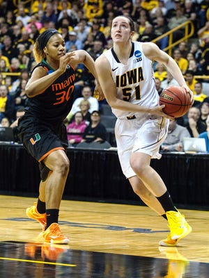 Iowa's Bethany Doolittle (51) drives to the basket in the first half during the second-round NCAA Tournament game against Miami. The senior scored 22 points and grabbed 11 rebounds in the win.